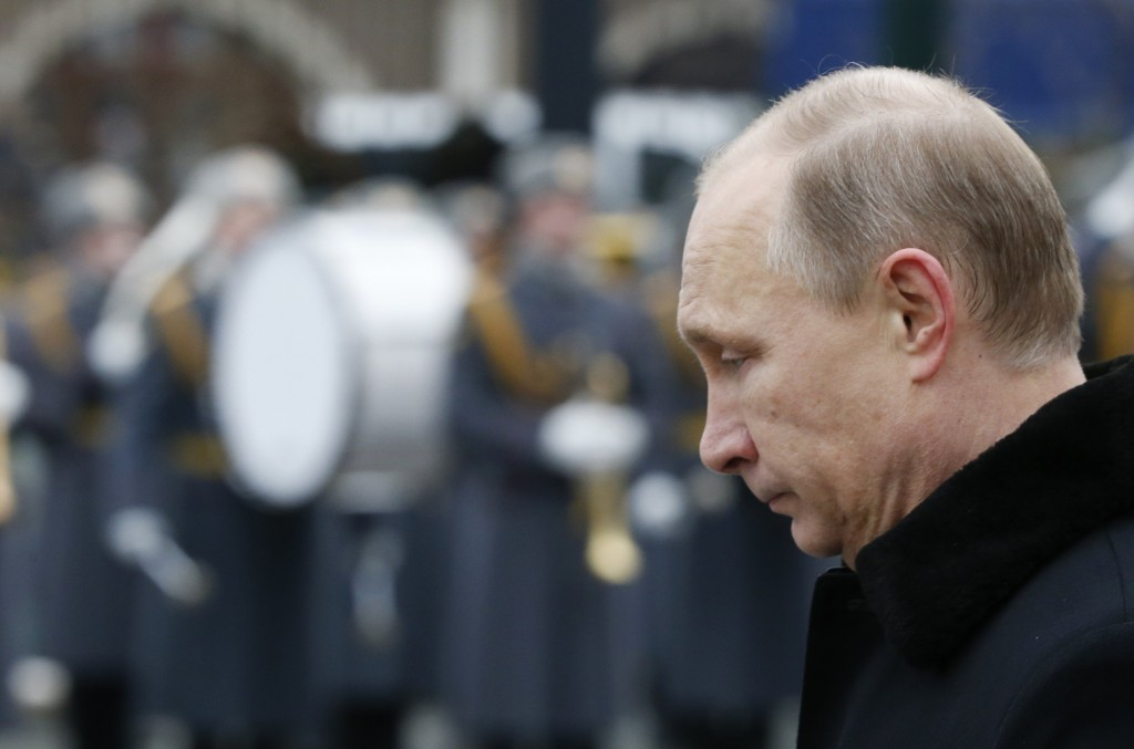 Russian President Vladimir Putin attends a wreath-laying ceremony to mark the Defender of the Fatherland Day at the Tomb of the Unknown Soldier by the Kremlin walls in central Moscow