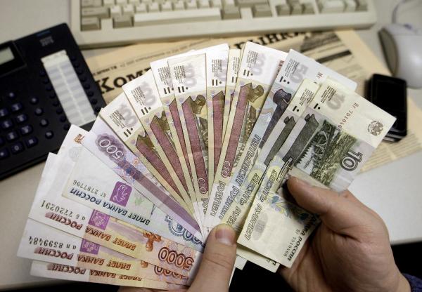 На российских деньгах появился государственный герб страны